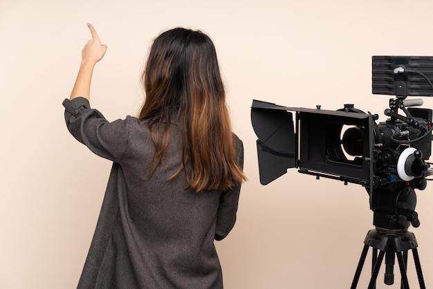 Journaliste, femme, pointage, quelque chose