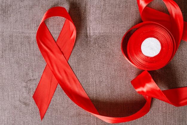 Journée internationale du sida, ruban rouge avec babina, 1er décembre
