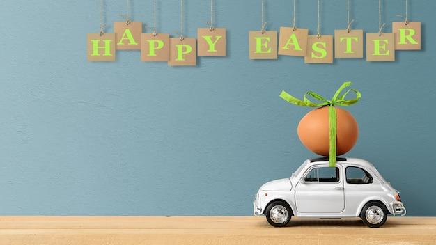 Joyeuses pâques concept. petite voiture rétro transportant un œuf de pâques sur le toit.