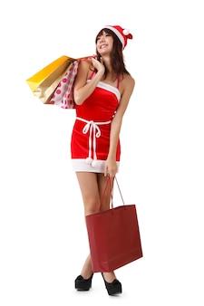Joyeux noël fille tenant des sacs à provisions.