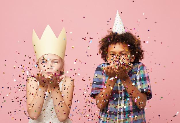 Kids blowing glitter