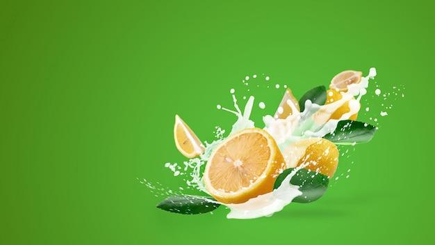 Lait éclaboussant et fruit de citron jaune isolé sur vert