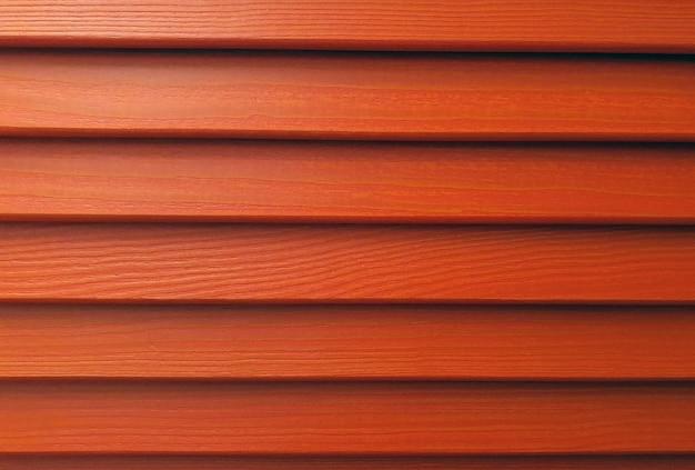 Lames en bois de stores fond rouge volets de parement volets en bois dur le fond rouge