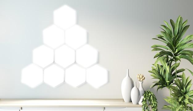 Lampe hexagonale sur mur et meuble en bois design minimaliste dans un style japonais moderne de chambre zen