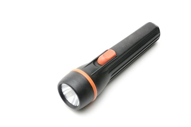 Lampe de poche en noir sur un espace blanc isolé