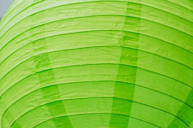 Lanterne chinoise de papier vert en arrière-plan