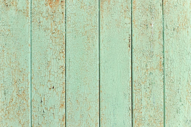 Lattes verticales, vieille peinture craquelée verte. contexte