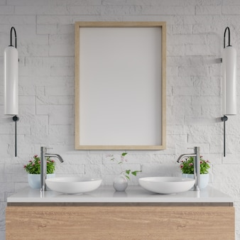 Lavabo de salle de bain blanc avec cadre blanc sur une étagère.