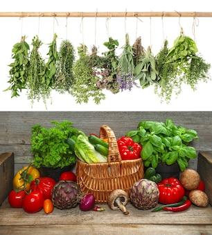 Légumes frais et herbes suspendues. ingrédients alimentaires crus. concept de bionutrition