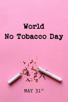 Lettrage de la journée mondiale sans tabac sur fond rose. arrêter de fumer concept