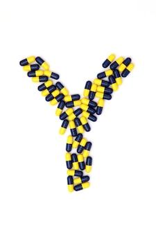 La lettre un alphabet composé de capsules médicales