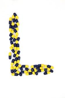 La lettre l alphabet faite de capsules médicales