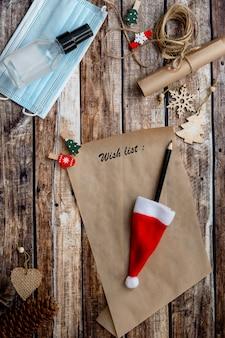 Lettre au père noël, liste de souhaits de noël sur fond de bois entre les vacances