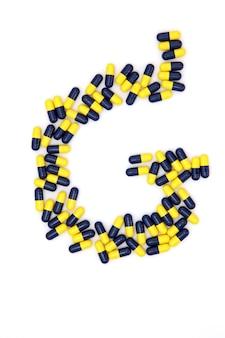 La lettre g alphabet faite de capsules médicales