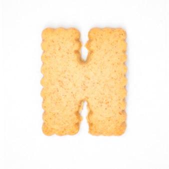 Lettre h faite de biscuit de biscuit isolé sur fond blanc