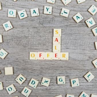Lettres formant les mots vente et offre