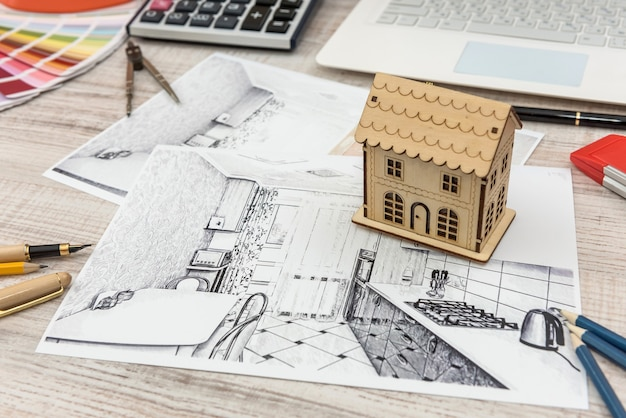 Lieu de travail d'architecte. esquisser un projet architectural avec des outils d'ingénierie, un échantillonneur de couleurs pour la création