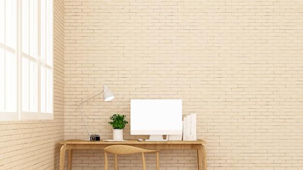 Le lieu de travail et le mur de briques décorent.