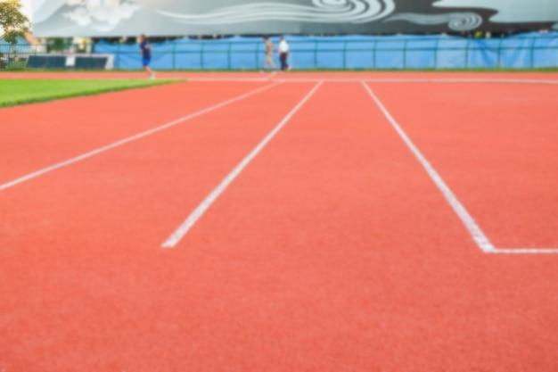 Ligne blanche sur le sol sportif dans le stade.