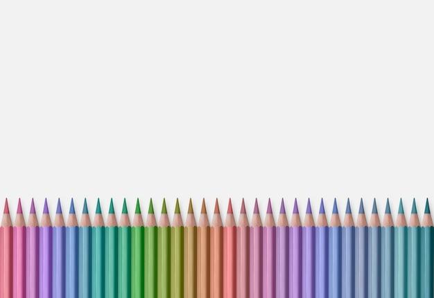 Ligne de crayons de couleur isolé sur fond blanc
