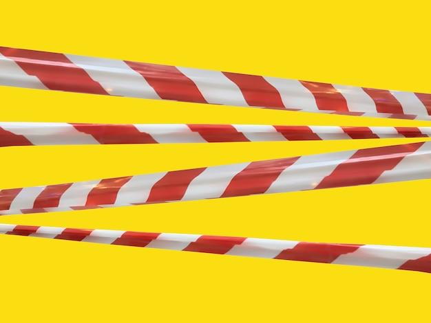 Les lignes d'avertissement rouges et blanches du ruban barrière interdisent le passage. ruban de barrière sur isolat jaune. barrière qui interdit la circulation. danger avertissement zone dangereuse n'entrez pas. concept de pas d'entrée. espace de copie
