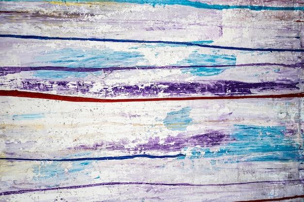 Lignes colorées de fond de peinture abstraite et éclaboussures de peinture acrylique sur une surface de mur blanc haute q...