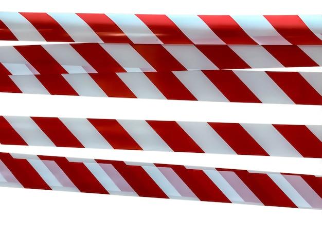 Des lignes rouges et blanches de ruban adhésif interdisent le passage. ruban de barrière sur isolat blanc. barrière qui interdit la circulation. ruban d'avertissement. danger avertissement zone dangereuse n'entrez pas. concept de non-entrée