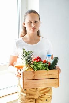 Livraison à domicile de légumes écologiques frais et de lait