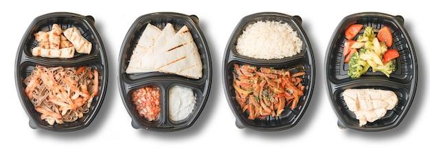 Livraison de nourriture sur fond blanc. plats diététiques pour les végétaliens.