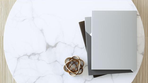 Livre à couverture vierge ou magazine sur une table en marbre blanc vide.