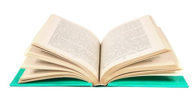 Le livre ouvert sur fond blanc