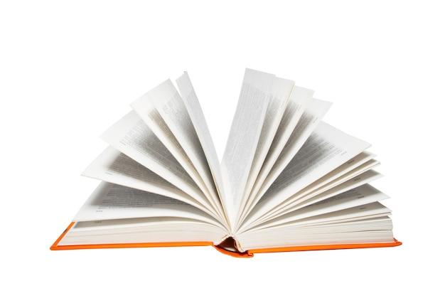 Livre ouvert isolé sur blanc.