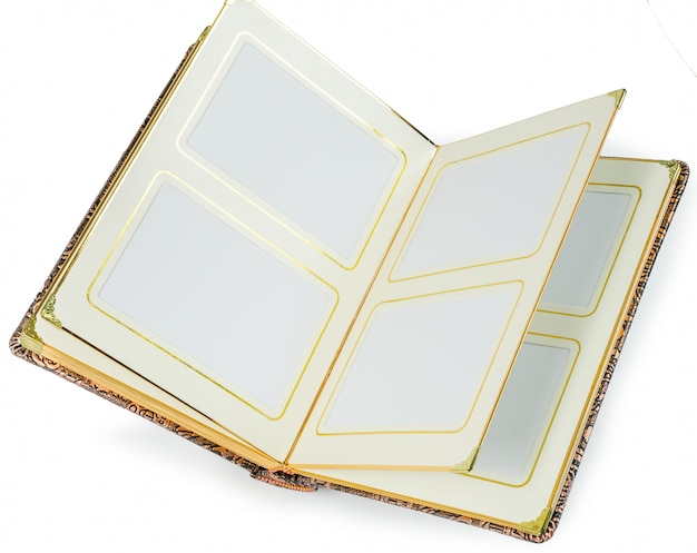 Livre ouvert avec des pages blanches et un cadre décoratif pour le texte