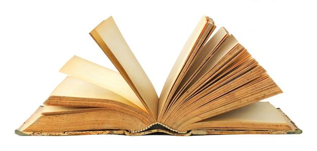 Un livre ouvert vue latérale isolé sur blanc