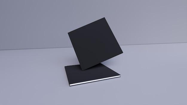Livres noirs vierges sur fond gris