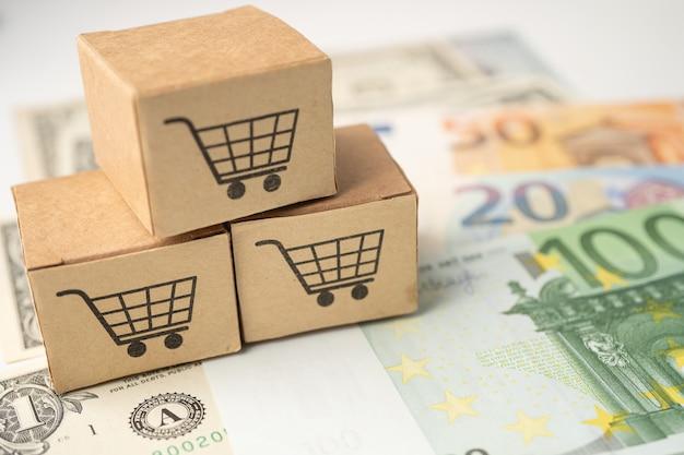Logo de panier d'achat sur la boîte avec des billets en dollars américains et en euros
