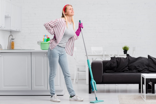 Low angle woman at home cleaning