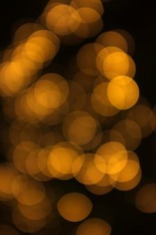 Lumière abstraite de bokeh doré, fond orange