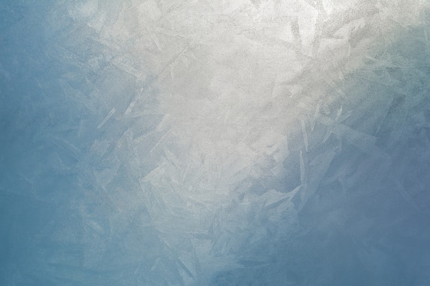 Lumière du jour, traversant l'épaisseur de la glace comme fond naturel. abstrait de la structure de la glace.