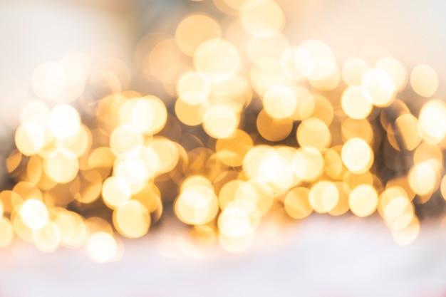 Lumière d'or défocalisé abstrait texture de fond de noël ou de vacances, tons chauds flous jaunes pétillants colorés