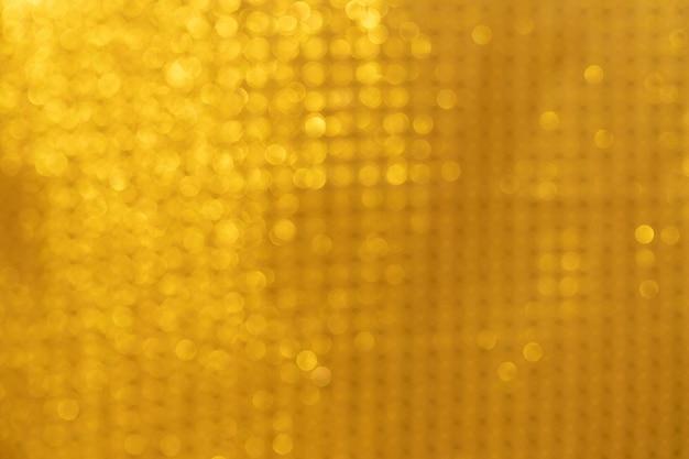 Lumières abstraites d'or de fond d'or de bokeh