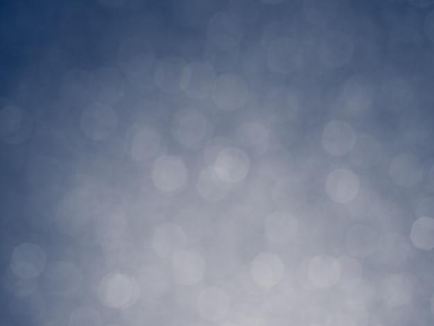 Lumières bleues abstraites argent glister bokeh fond concept copie espace brillant lumières brouillées