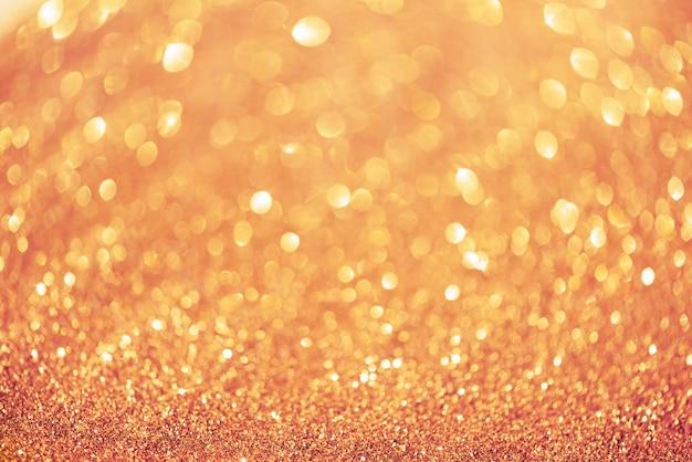 Lumières de bokeh abstraites roses et or.
