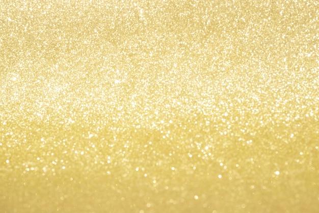 Lumières de bokeh de paillettes d'or abstraites avec fond clair et doux.