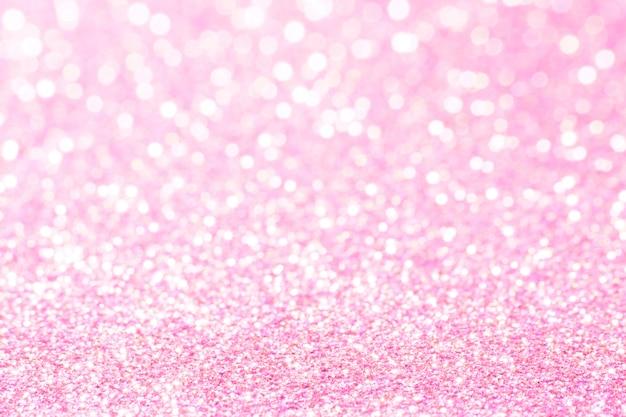 Lumières de bokeh roses et blanches sans mise au point. abstrait