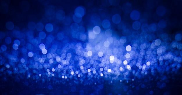 Lumières brouillées abstraites de bokeh rose et bleu.