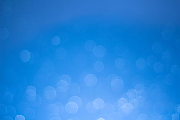 Lumières défocalisé abstrait bokeh comme fond d'eau de pulvérisation, balance des blancs différente