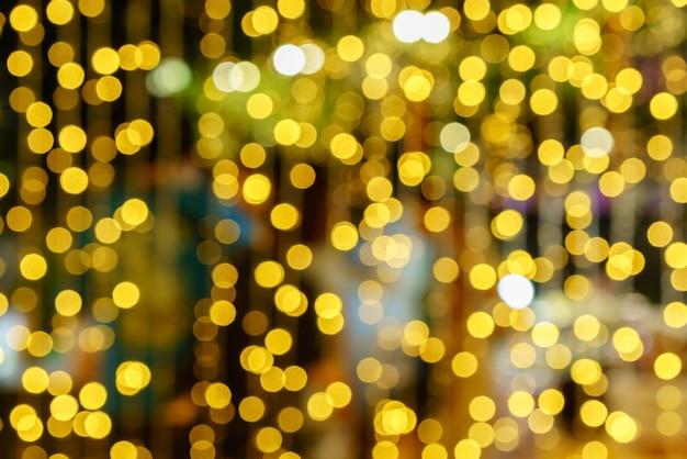 Lumières défocalisés abstrait fond de bokeh nonagon doré