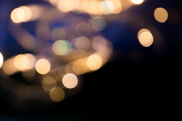 Lumières floues de bokeh sur scène, image abstraite de l'éclairage de concert
