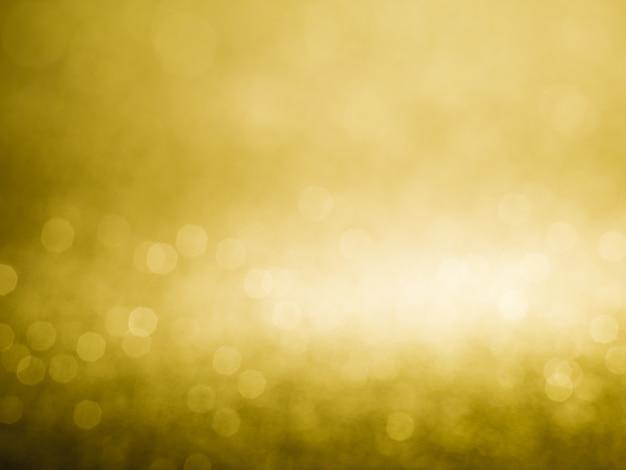 Lumières de noël de fond abstrait bokeh glister or